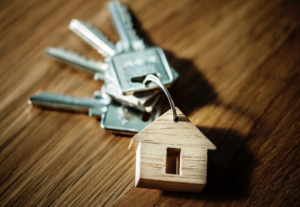 house keys on a wooden home keychain